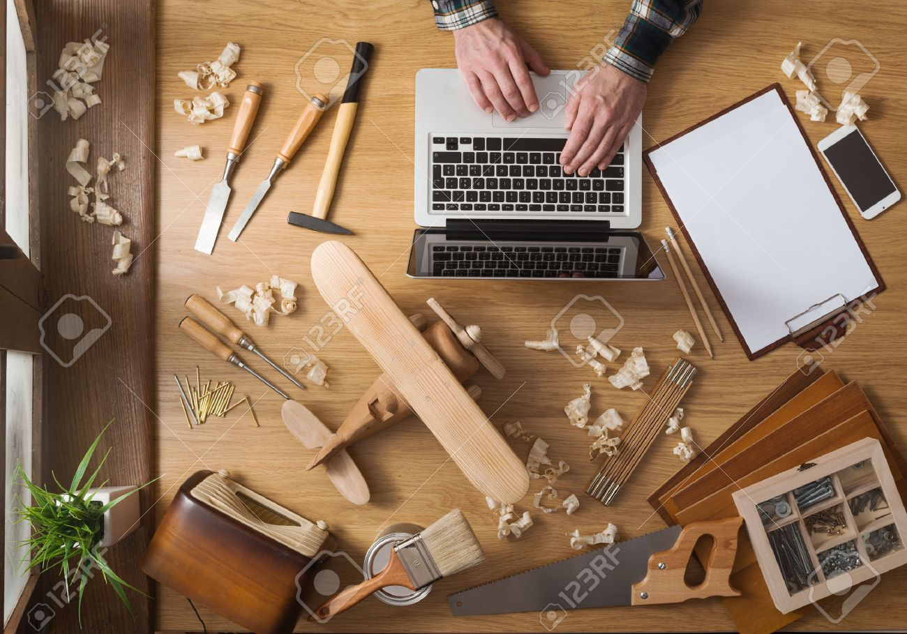 Man Working On A Diy Project With His Laptop Wood Shavings And