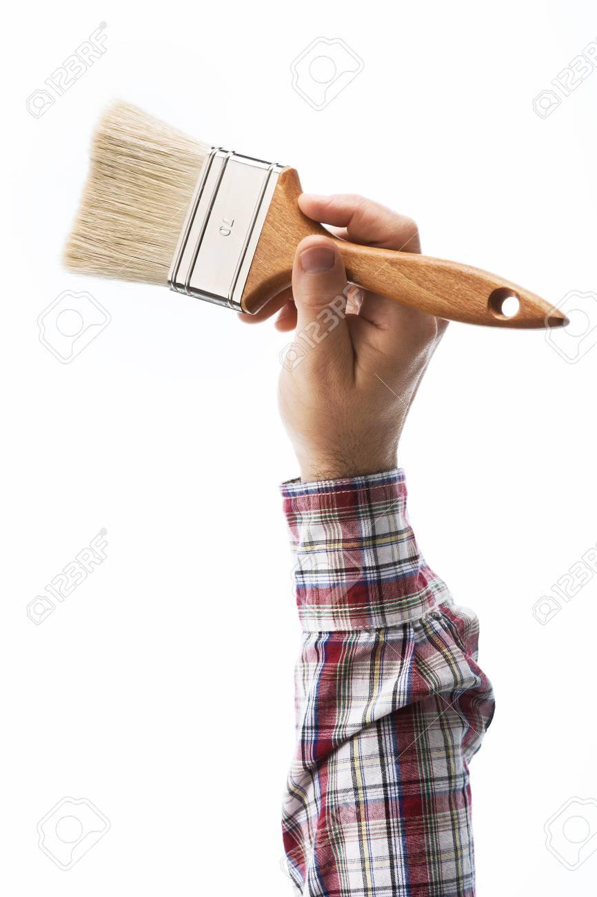 Dekorator Mannliche Hand Halt Einen Pinsel Auf Weissem Hintergrund