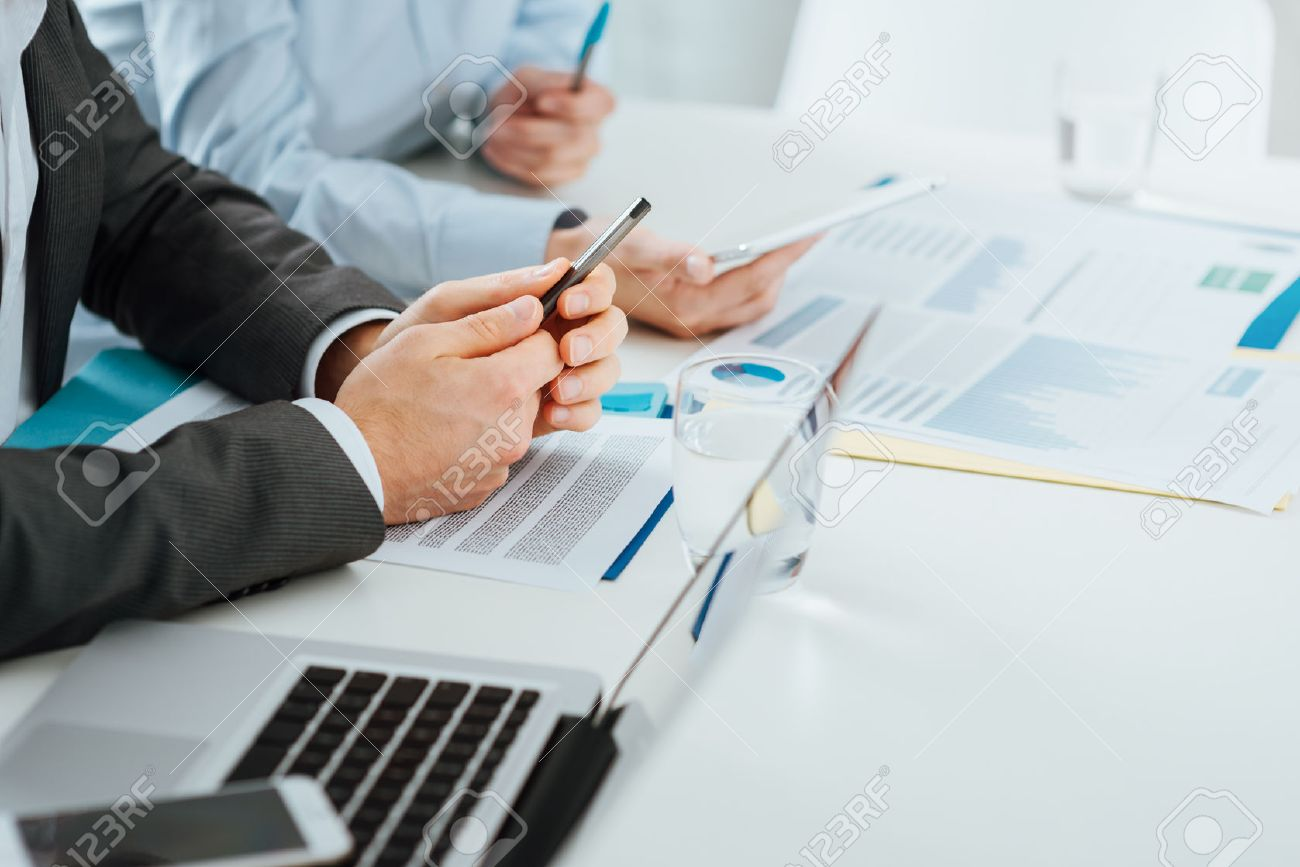 Business team working at office desk, unrecognizable people, hands close up Stock Photo - 42512044