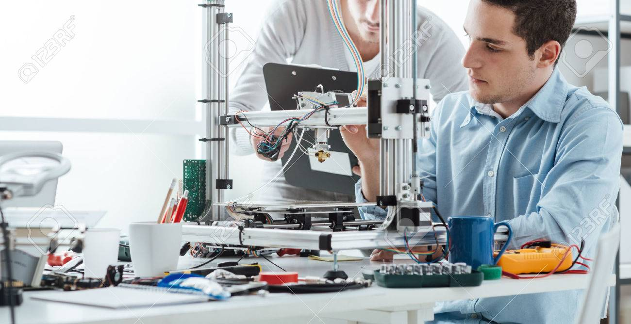 Engineering students using an innovative 3D printer in the laboratory - 51422809