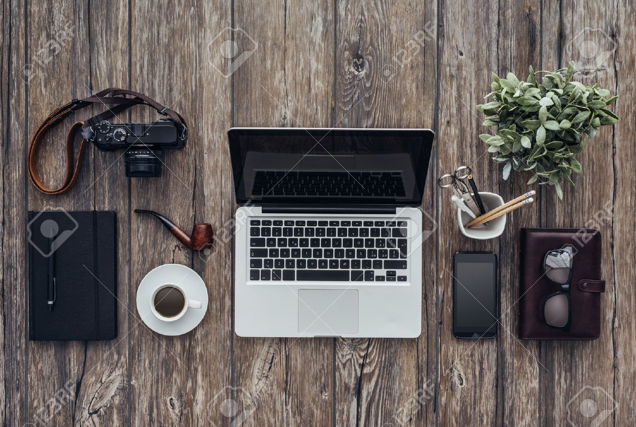 Hipster wooden desktop with laptop, camera, pipe and office accessories, flat lay banner Archivio Fotografico - 59102723