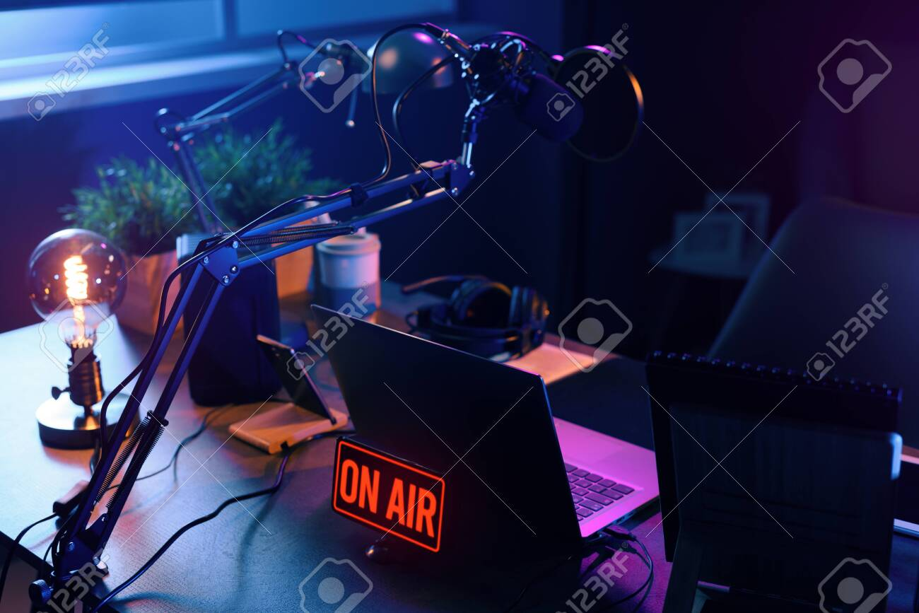 Live online radio broadcasting station desk with on air sign, entertainment and communication concept - 144053790