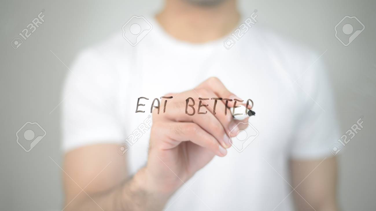 Eat Better, man writing on transparent screen - 85463174