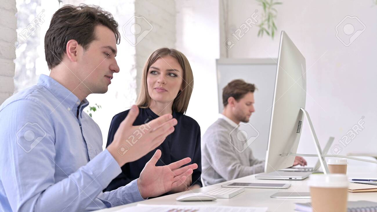 Startup Team doing Video Chat on Desktop in Office - 140044534
