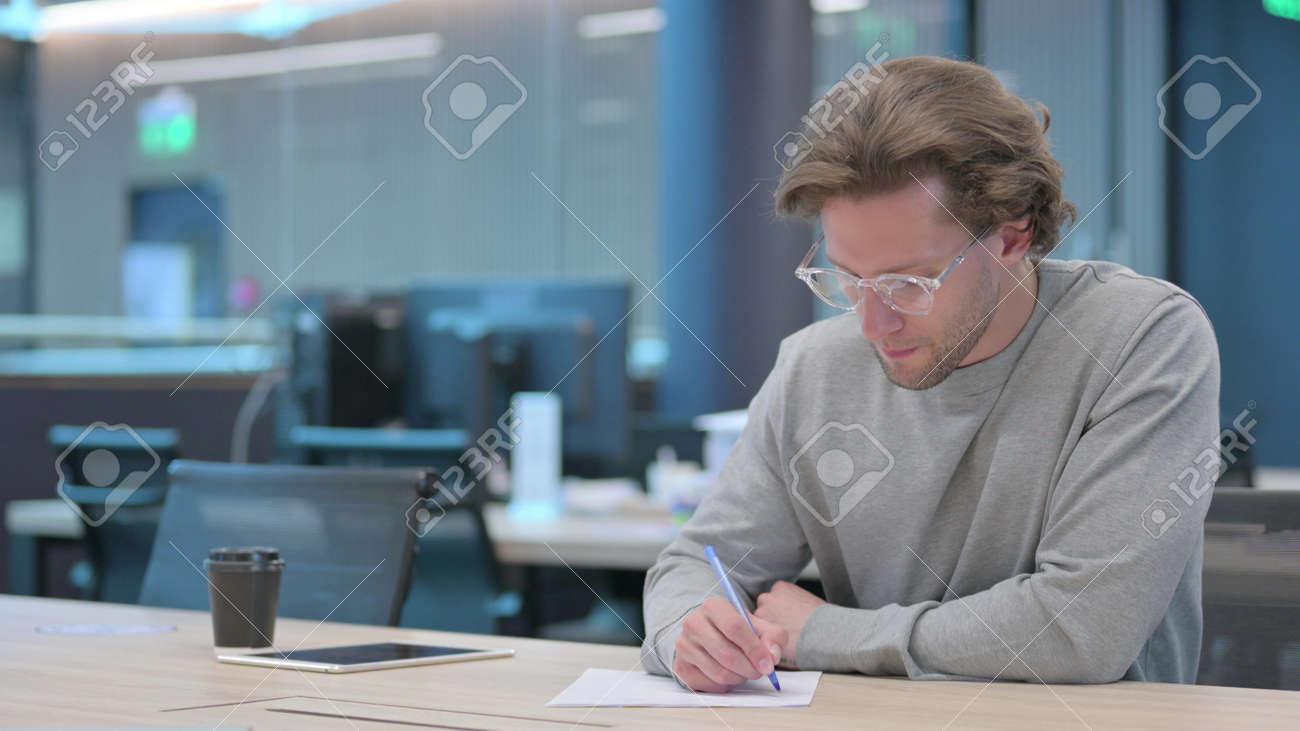 Young Man Trying to Write on Paper, Failure - 172194948