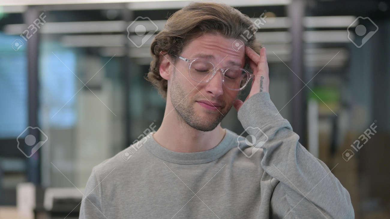 Portrait of Young Man having Headache - 172195138
