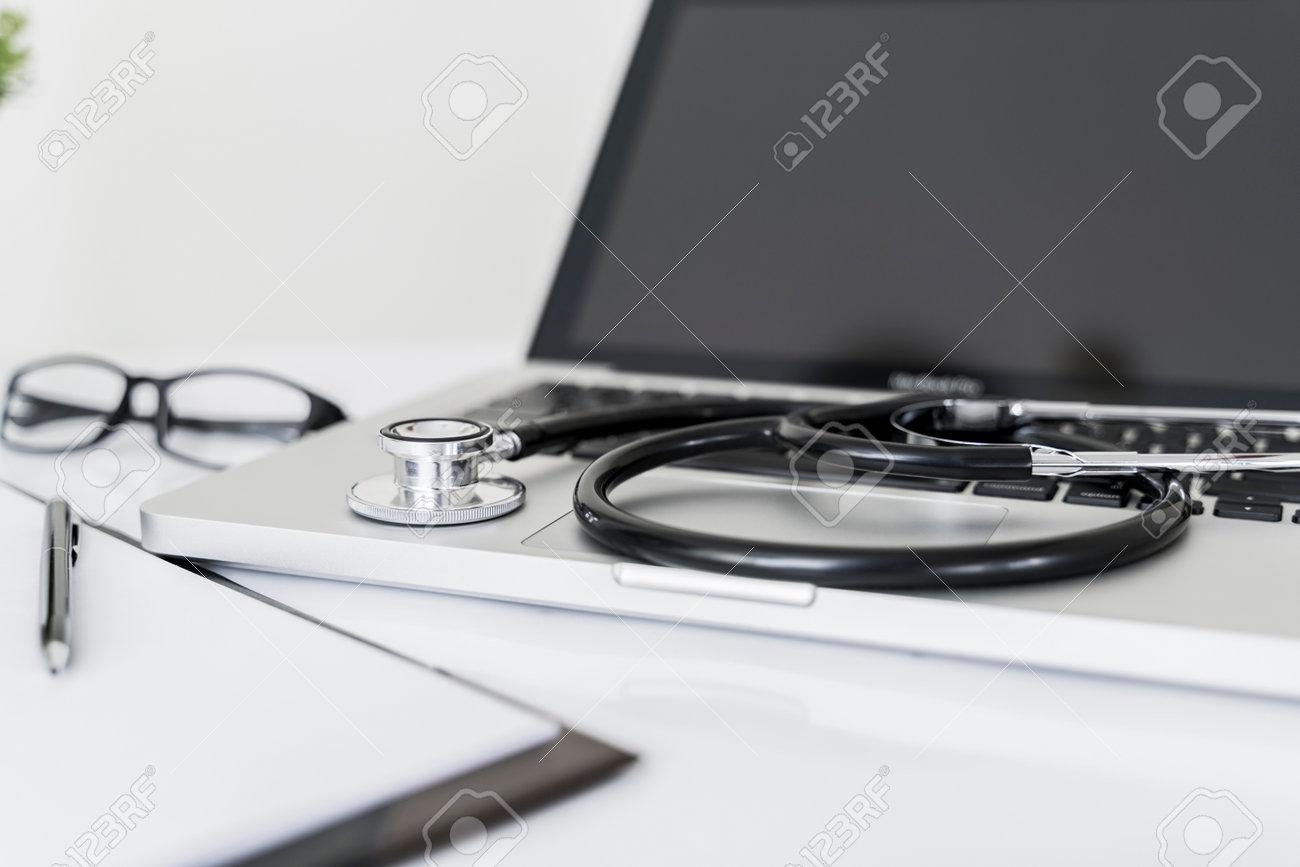 Stethoscope on laptop on doctor desk in office. - 170462069