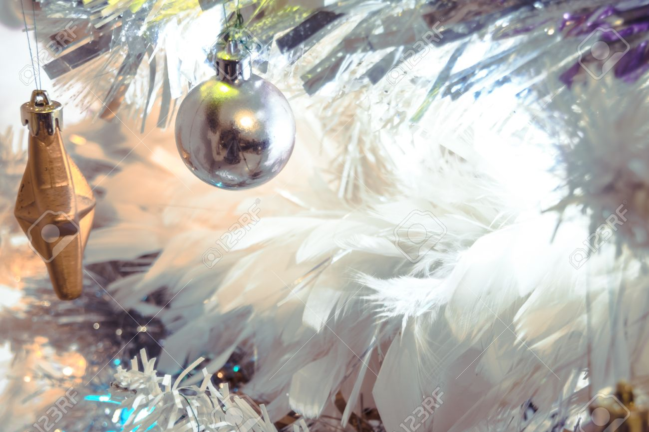 a110fdce a festive and modern white christmas tree with feathers, tinsil,lights..