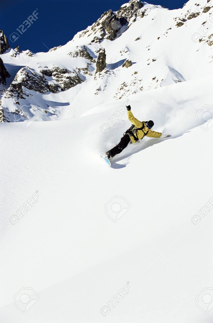 Snowboarder coming down hill Stock Photo - 3177929