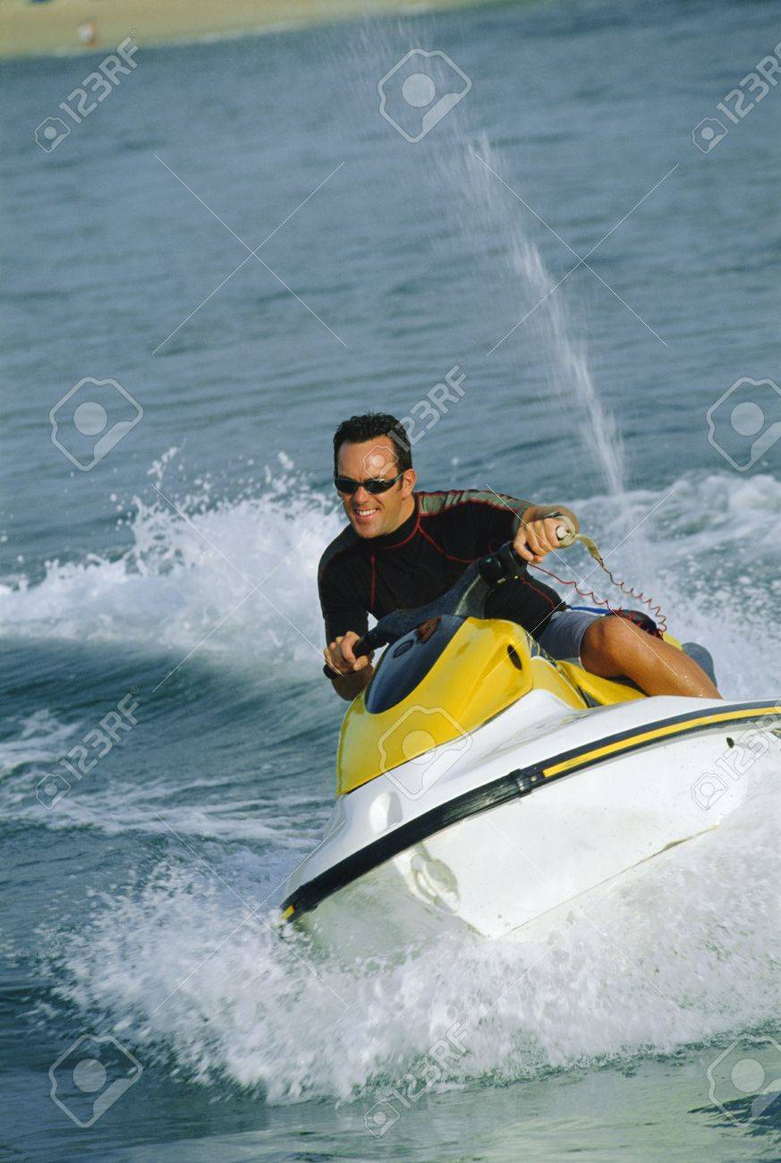 Man jet skiing and smiling (selective focus) Stock Photo - 3196268