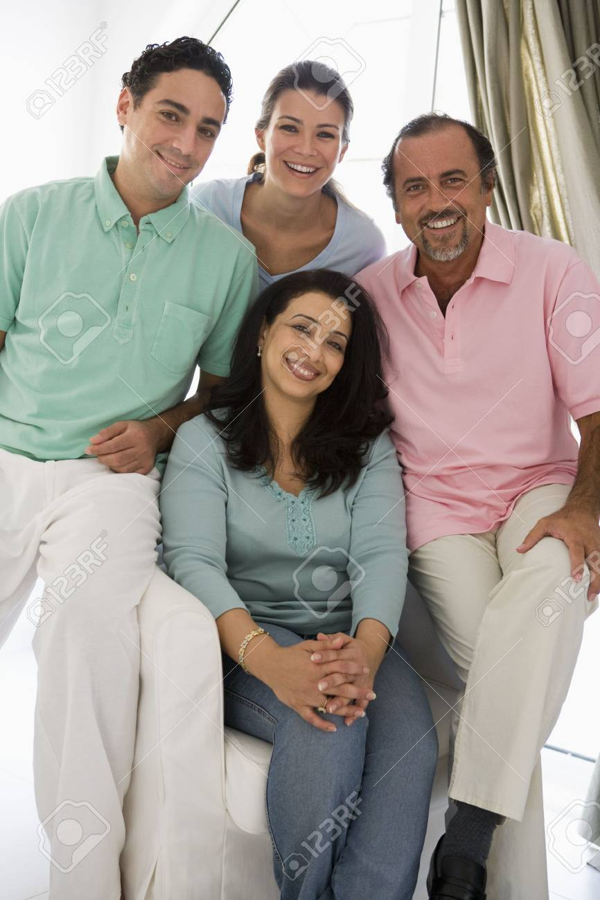 Two couples in living room smiling (high key) Stock Photo - 3186291