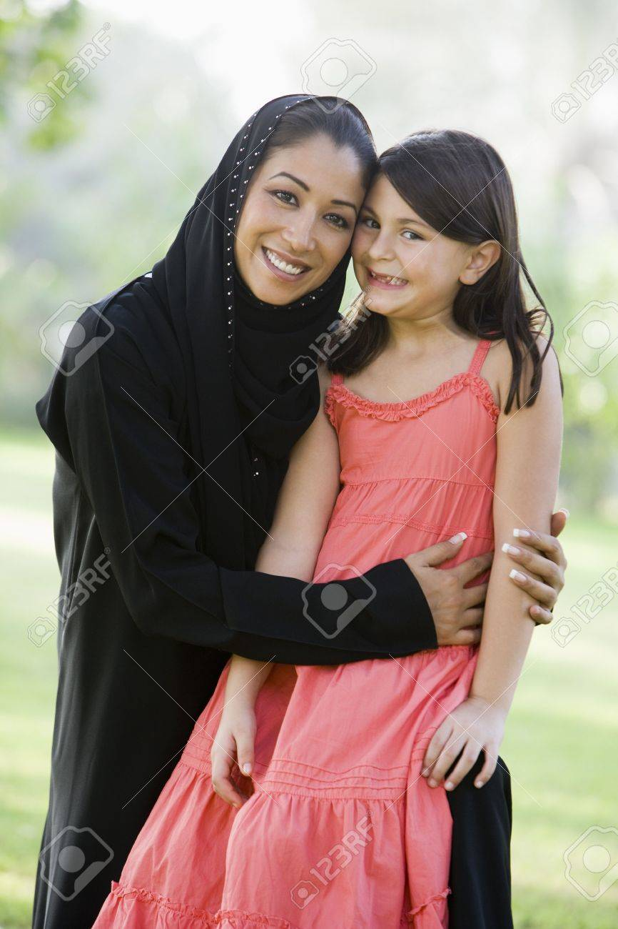Woman and young girl outdoors in a park smiling (selective focus) Stock Photo - 3186730