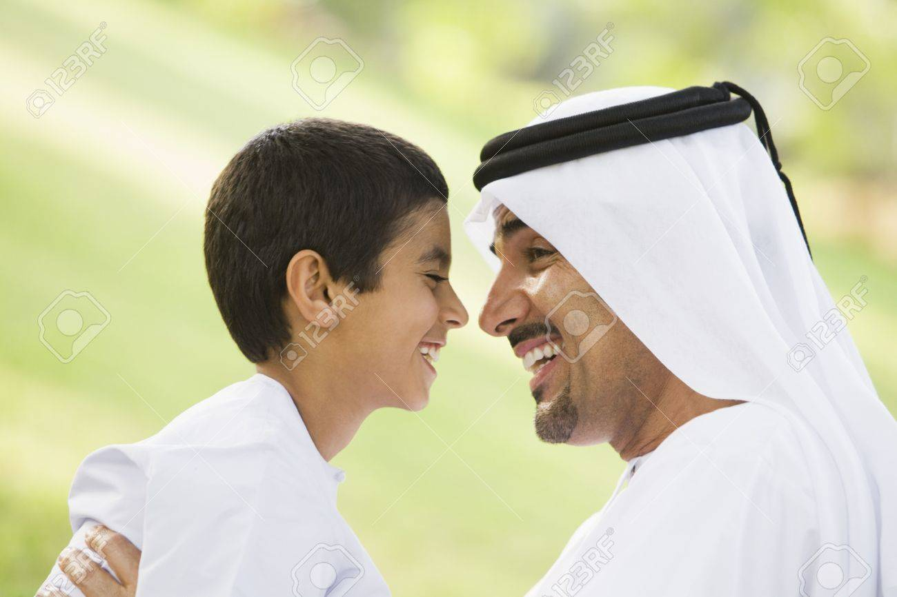 Man and young boy outdoors in park smiling (selective focus) Stock Photo - 3186918
