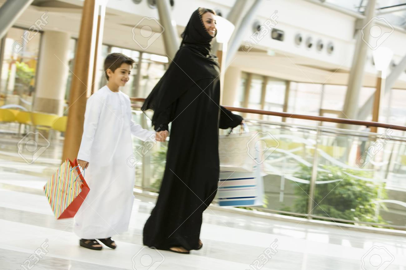 Woman and young boy walking in mall smiling (selective focus) Stock Photo - 3186862