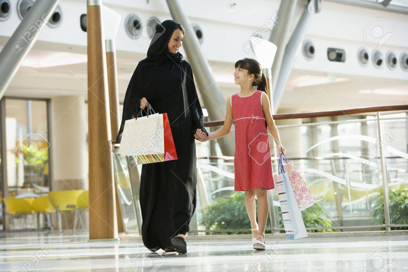 Woman and young girl walking in mall smiling (selective focus) Stock Photo - 3186716