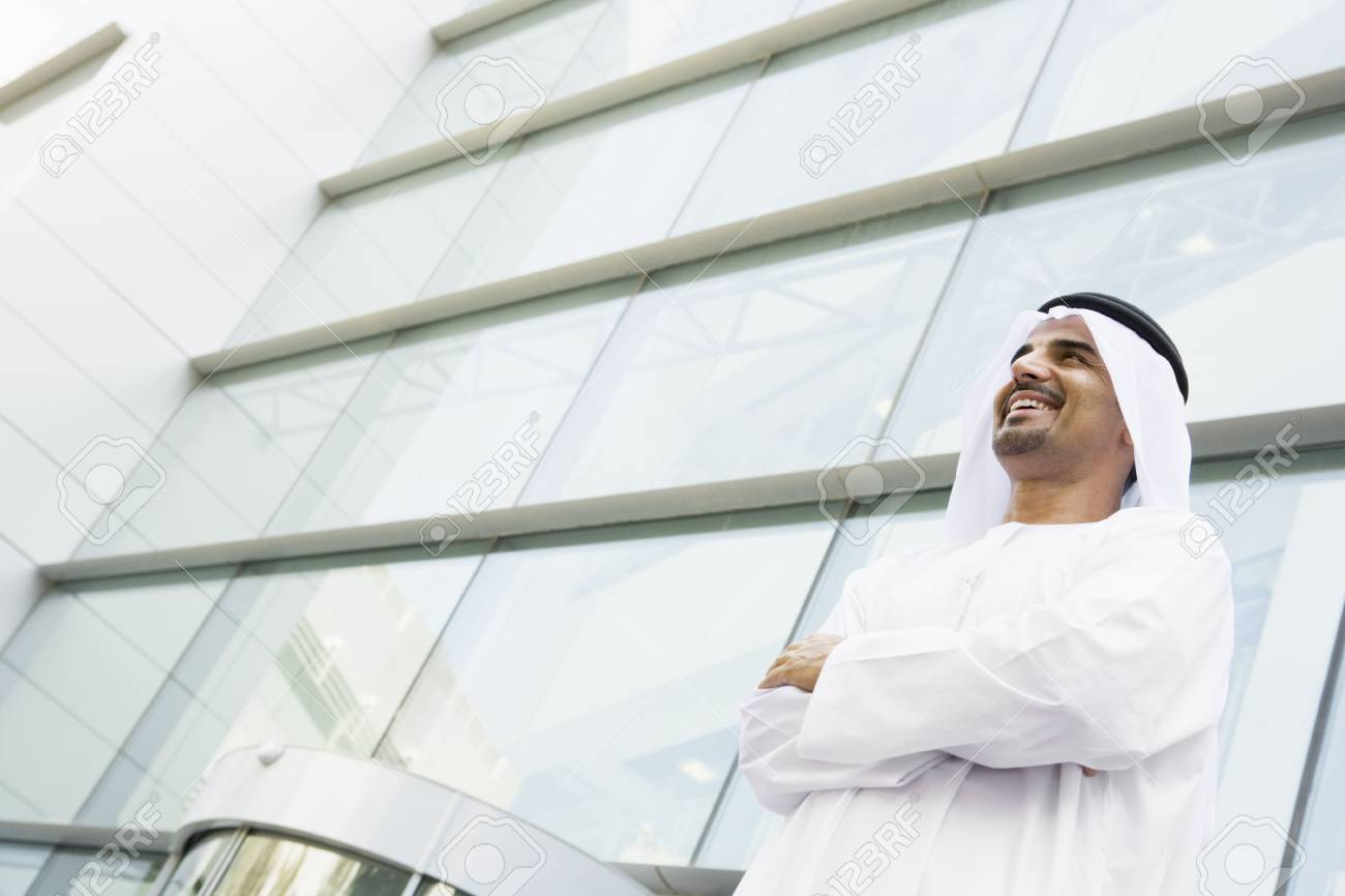 Businessman standing outdoors by building smiling Stock Photo - 3186908