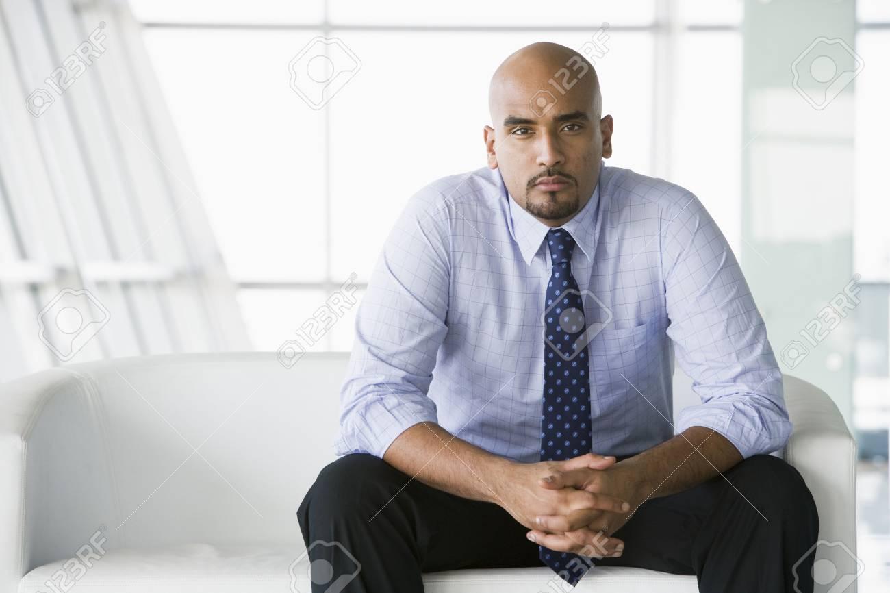 Businessman sitting indoors (high key/selective focus) Stock Photo - 3171162