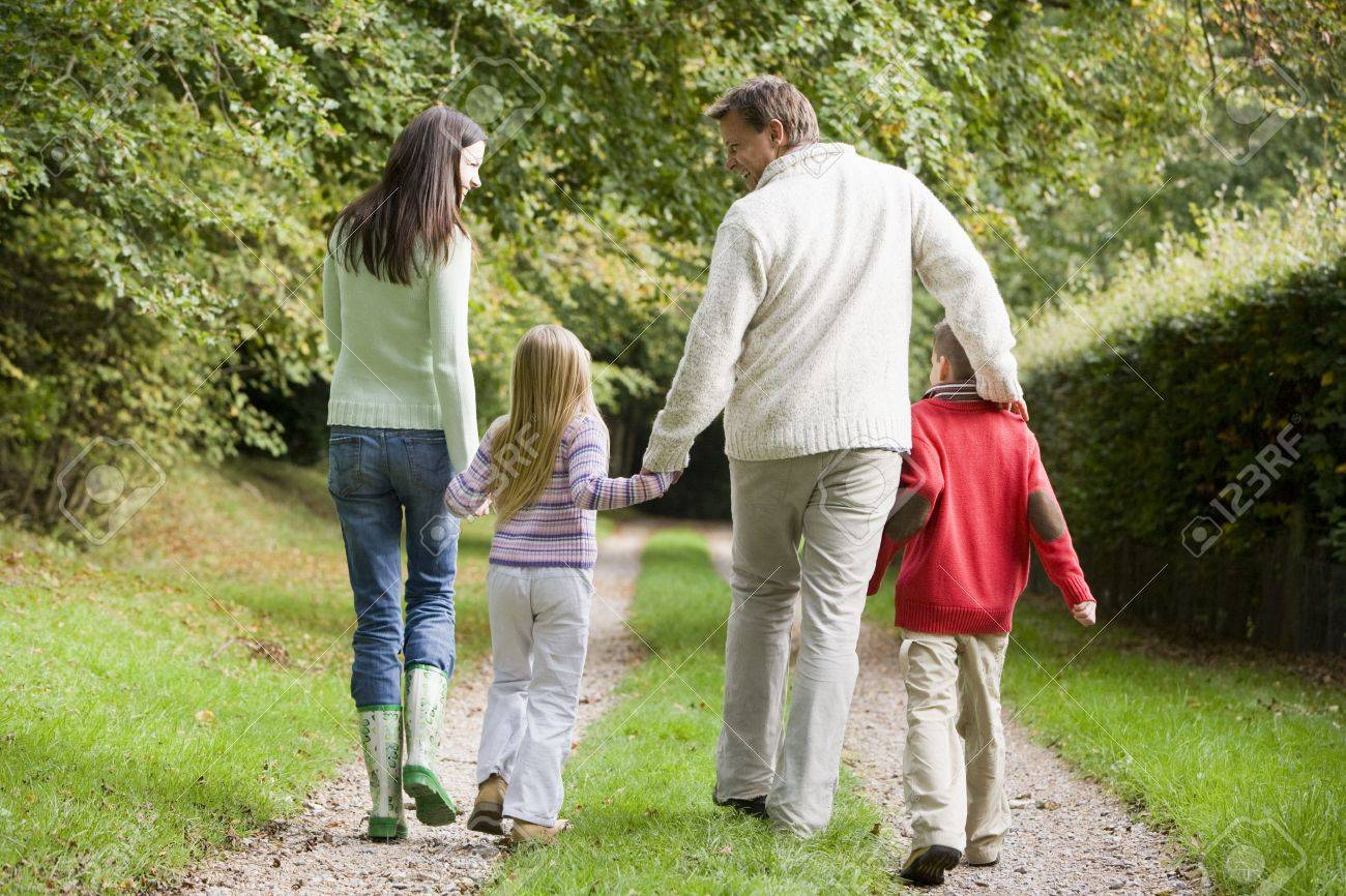 Family walking on path outdoors smiling (selective focus) Stock Photo - 3207786