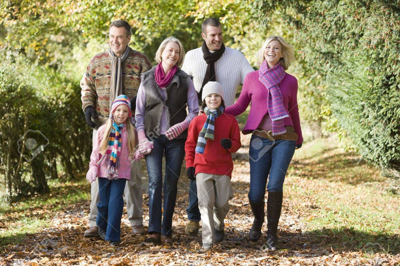 Family walking on path outdoors smiling (selective focus) Stock Photo - 3207788