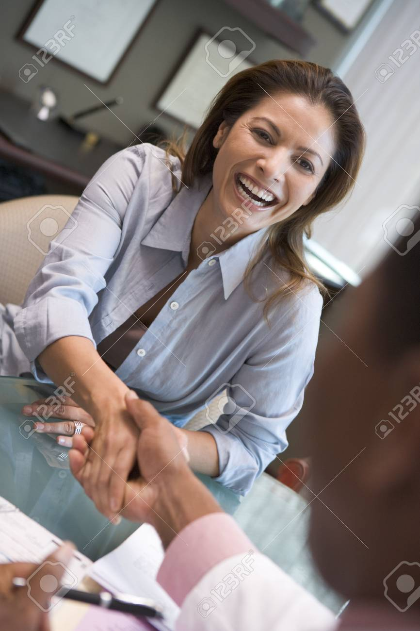 Woman shaking doctor's hand at IVF clinic (selective focus) Stock Photo - 3202441