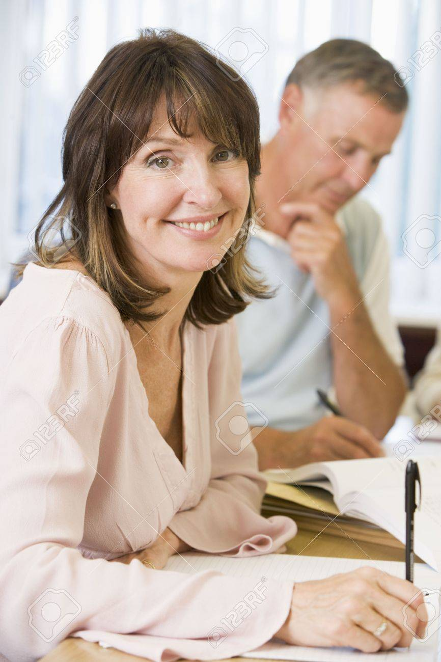 Adult students studying at table (selective focus) Stock Photo - 3174241