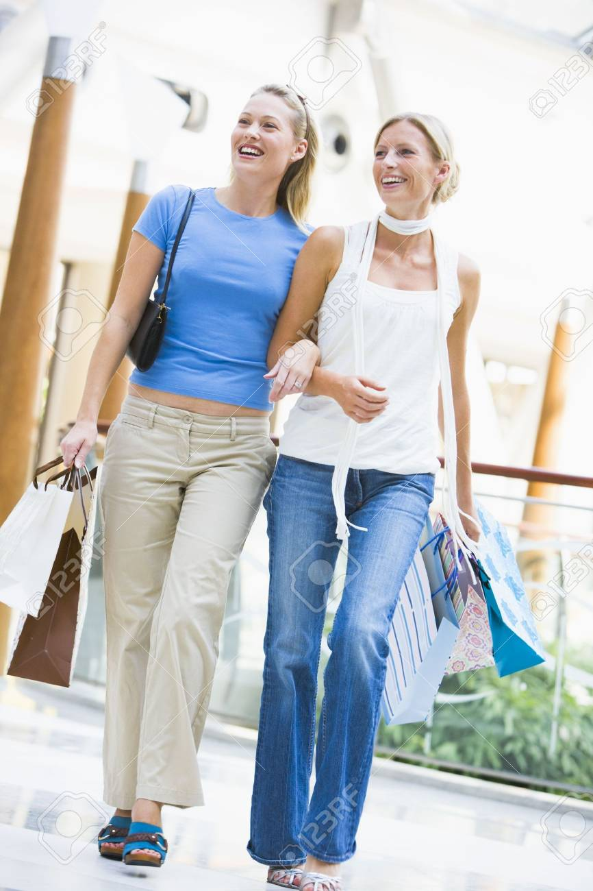 Two women at a shopping mall Stock Photo - 3197996