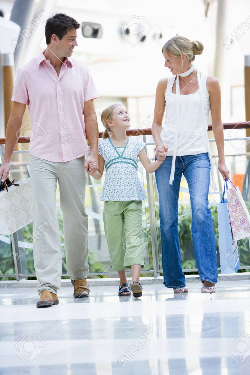 Mother and father with young daughter at a shopping mall Stock Photo - 3197962