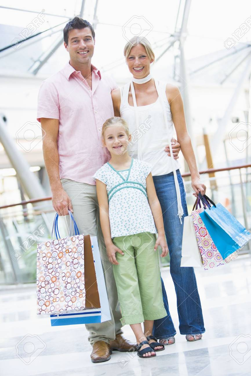 Mother and father with young daughter at a shopping mall Stock Photo - 3198048