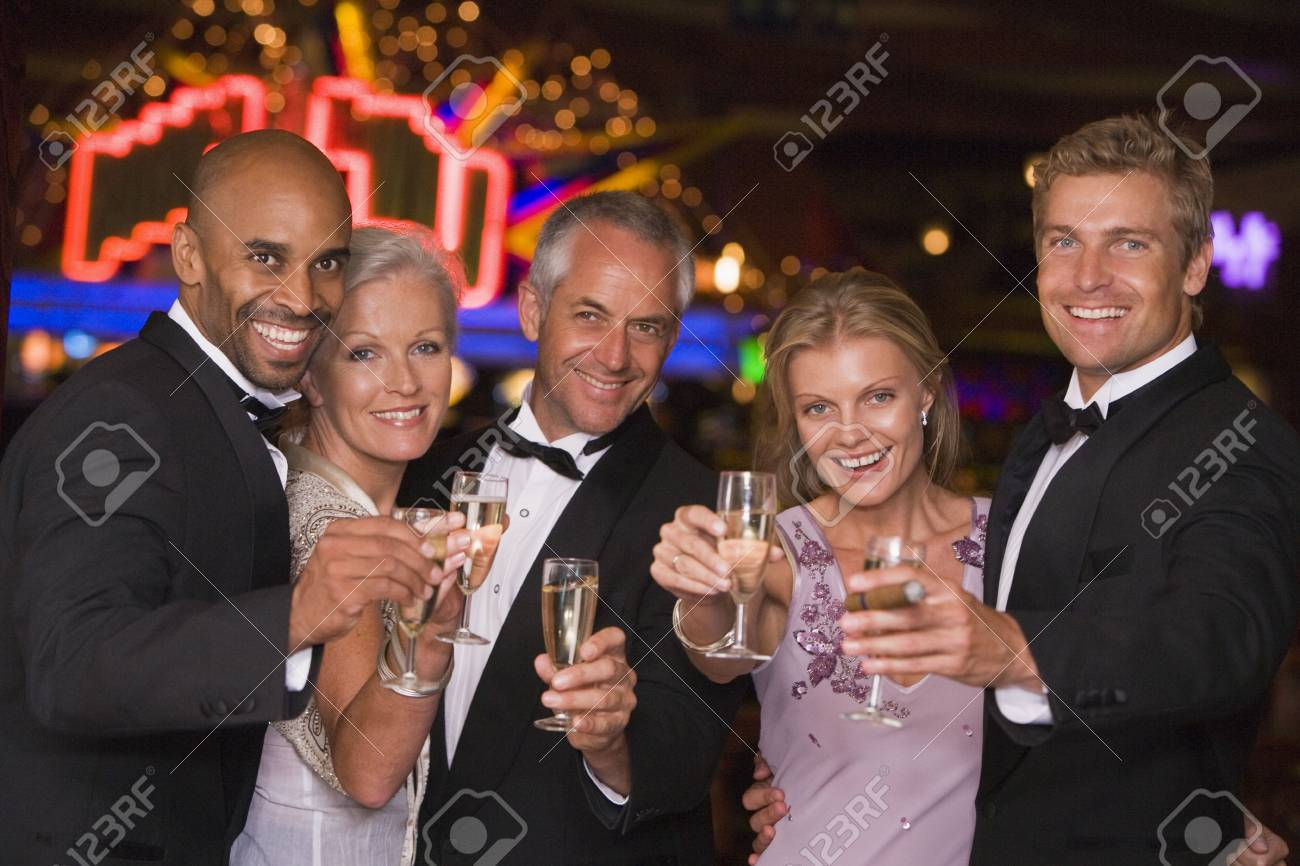 Five people in casino with champagne smiling (selective focus) Stock Photo - 3194448