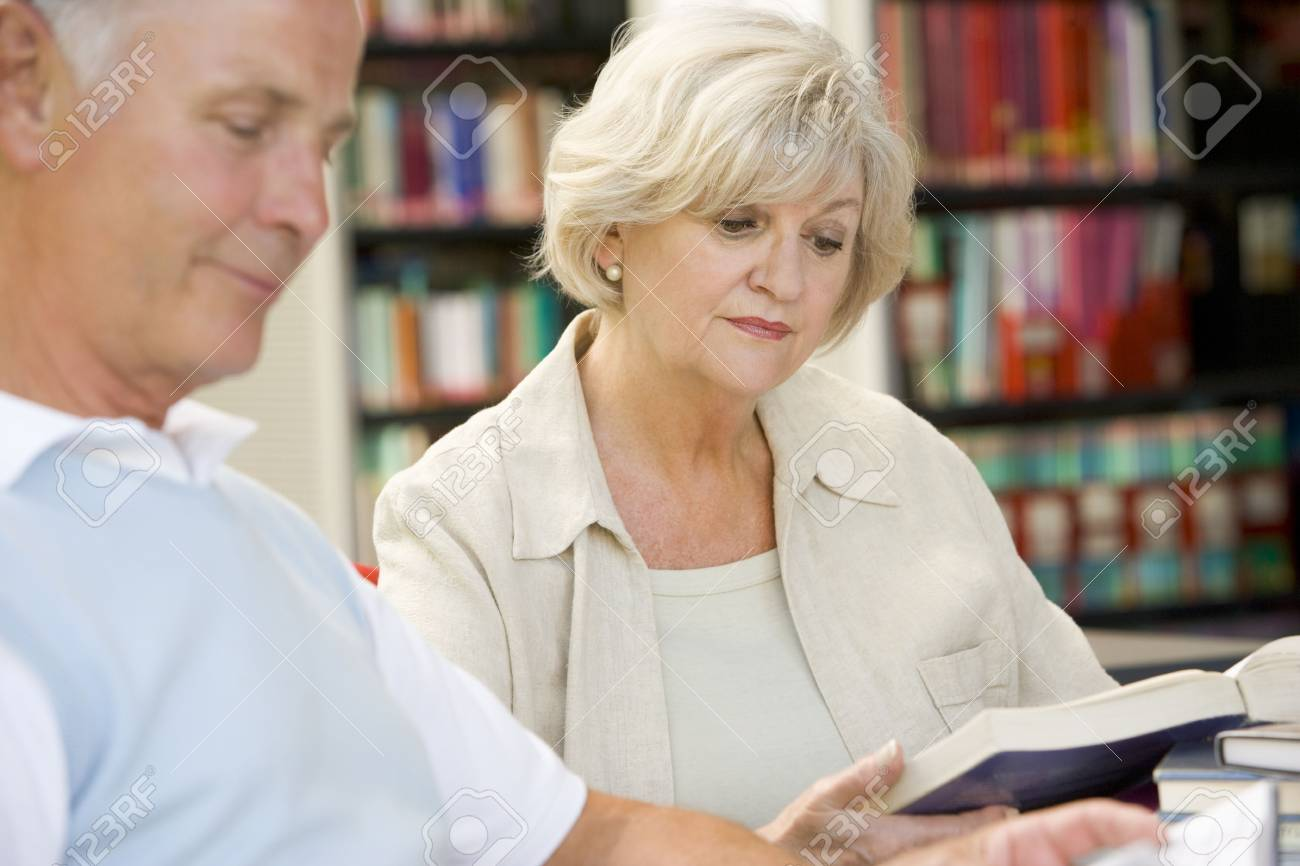 Man and woman in library reading (selective focus) Stock Photo - 4498622