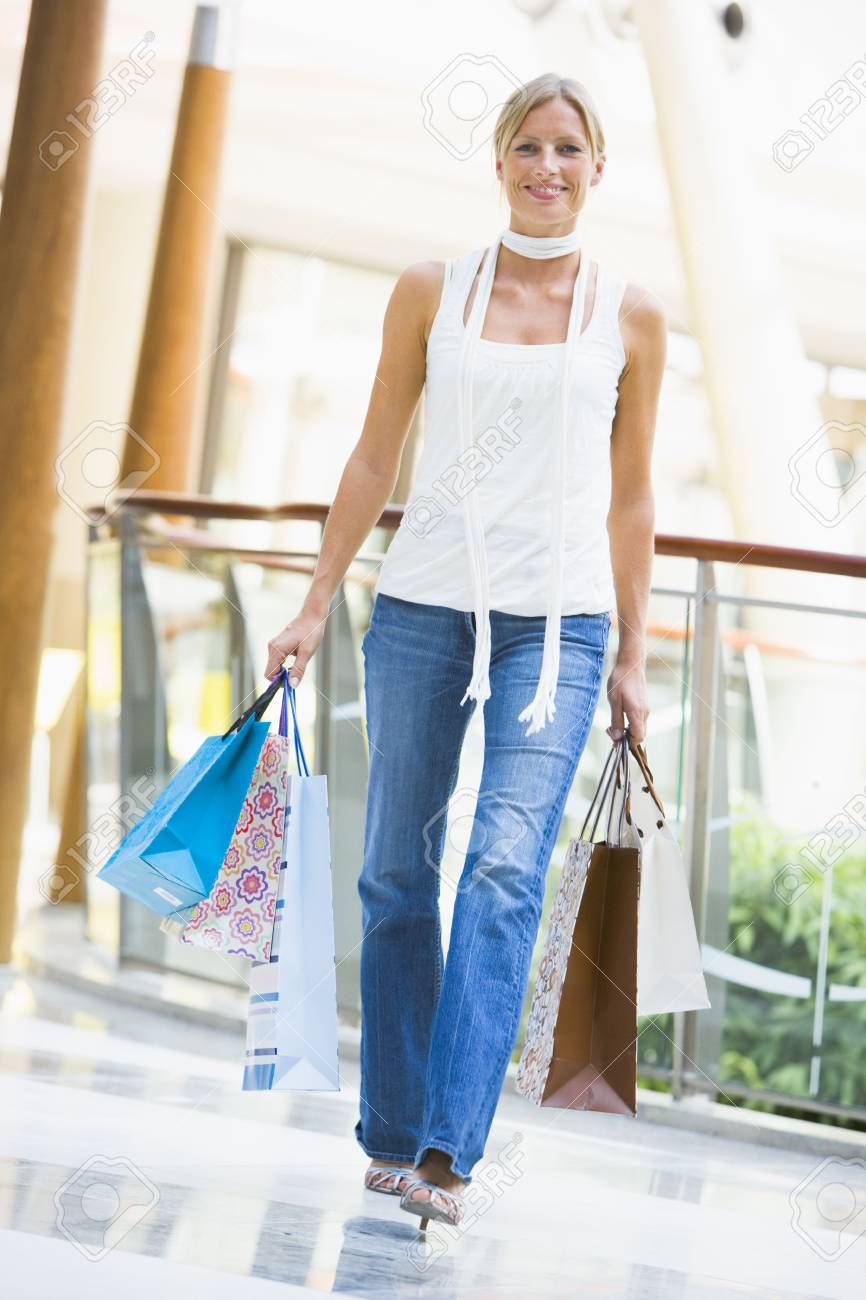 Woman with shopping bags at a shopping mall Stock Photo - 4498621
