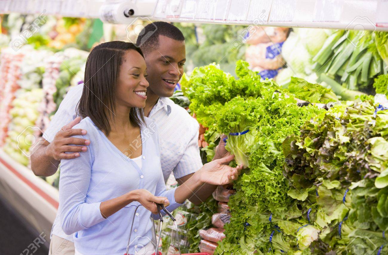 Young couple shopping for lettuce at a grocery store Stock Photo - 3218283