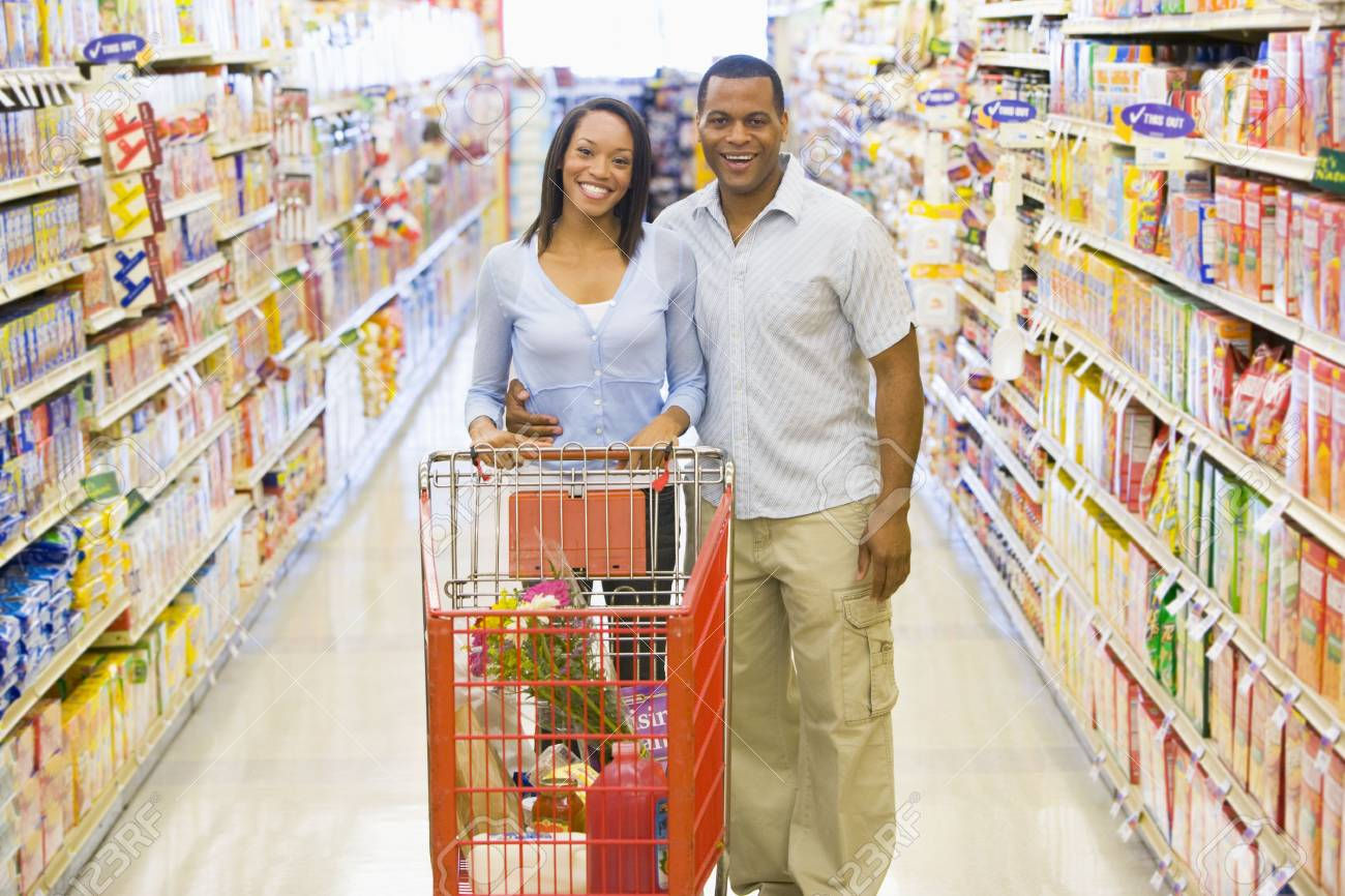 Young couple shopping at a grocery store Stock Photo - 3226657