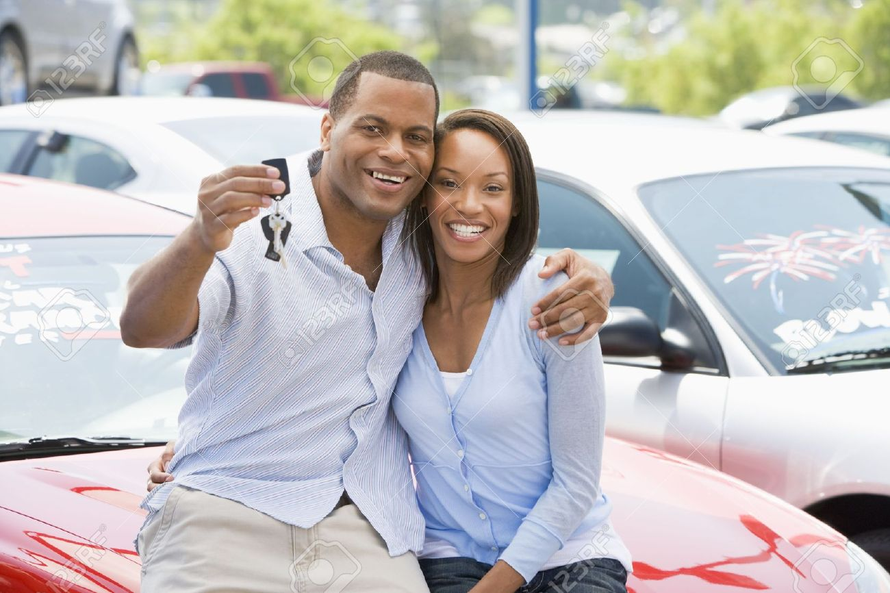 Young couple shopping for a new car Stock Photo - 3198239