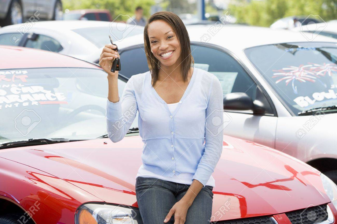 Woman shopping for a new car Stock Photo - 3197737