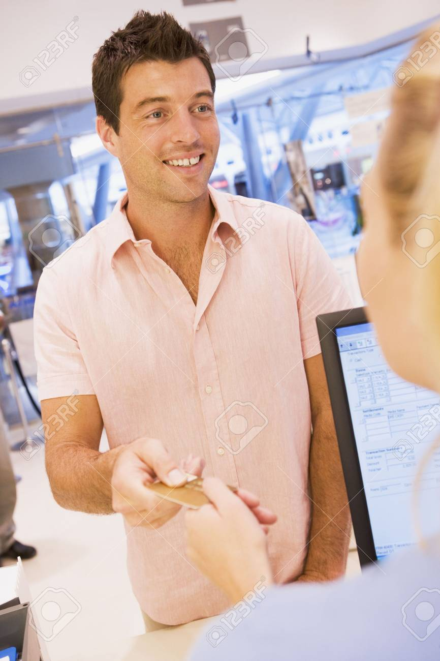 Man paying for purchases with credit card Stock Photo - 3198231