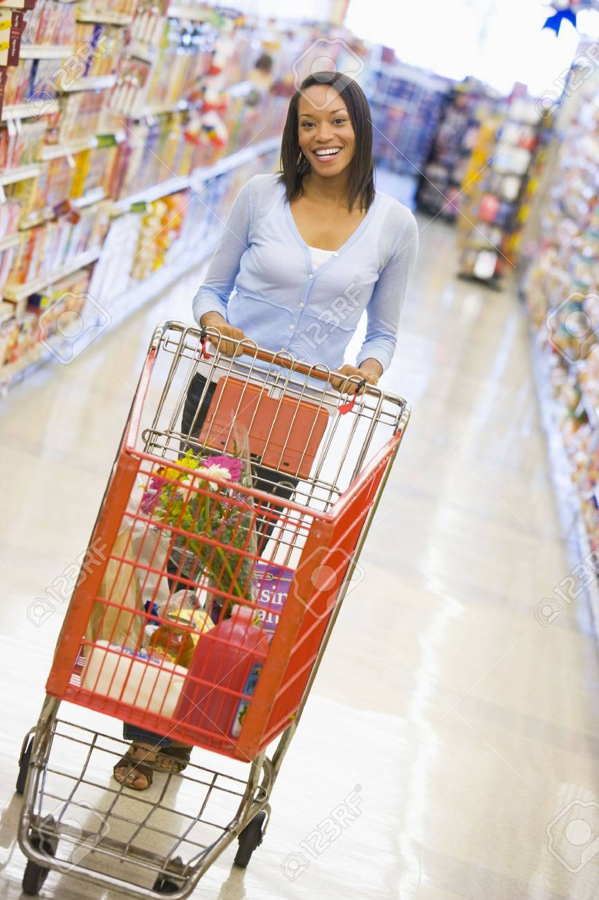 Woman shopping at a grocery store Stock Photo - 3202992