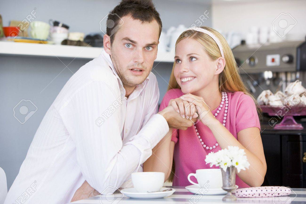 Young couple sitting at a table and having tea together Stock Photo - 3202339