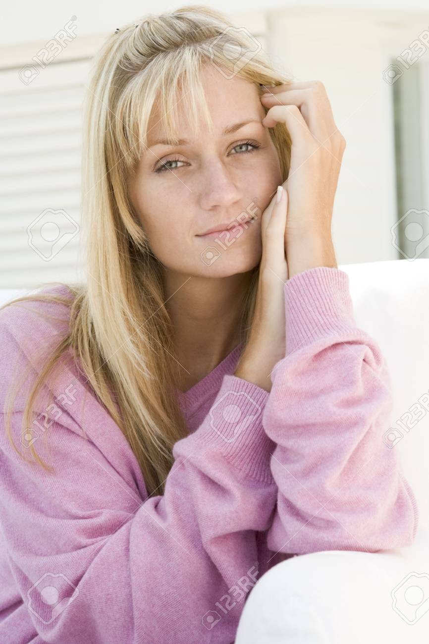Blonde woman in a pink sweater posing outdoors Stock Photo - 3203559