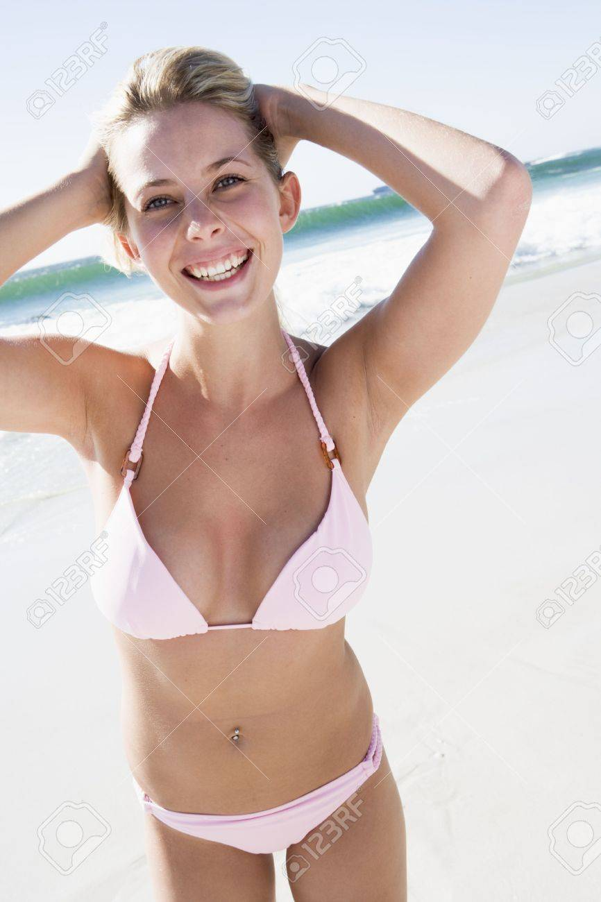 new photos great deals on fashion unique design Young woman in a two piece bathing suit on a beach