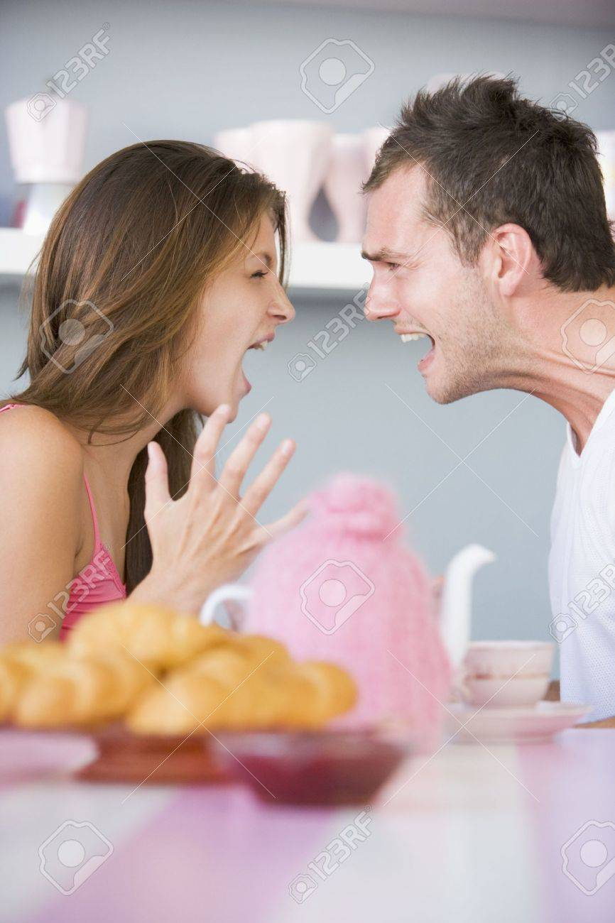 Young couple sitting at a table arguing Stock Photo - 3201839