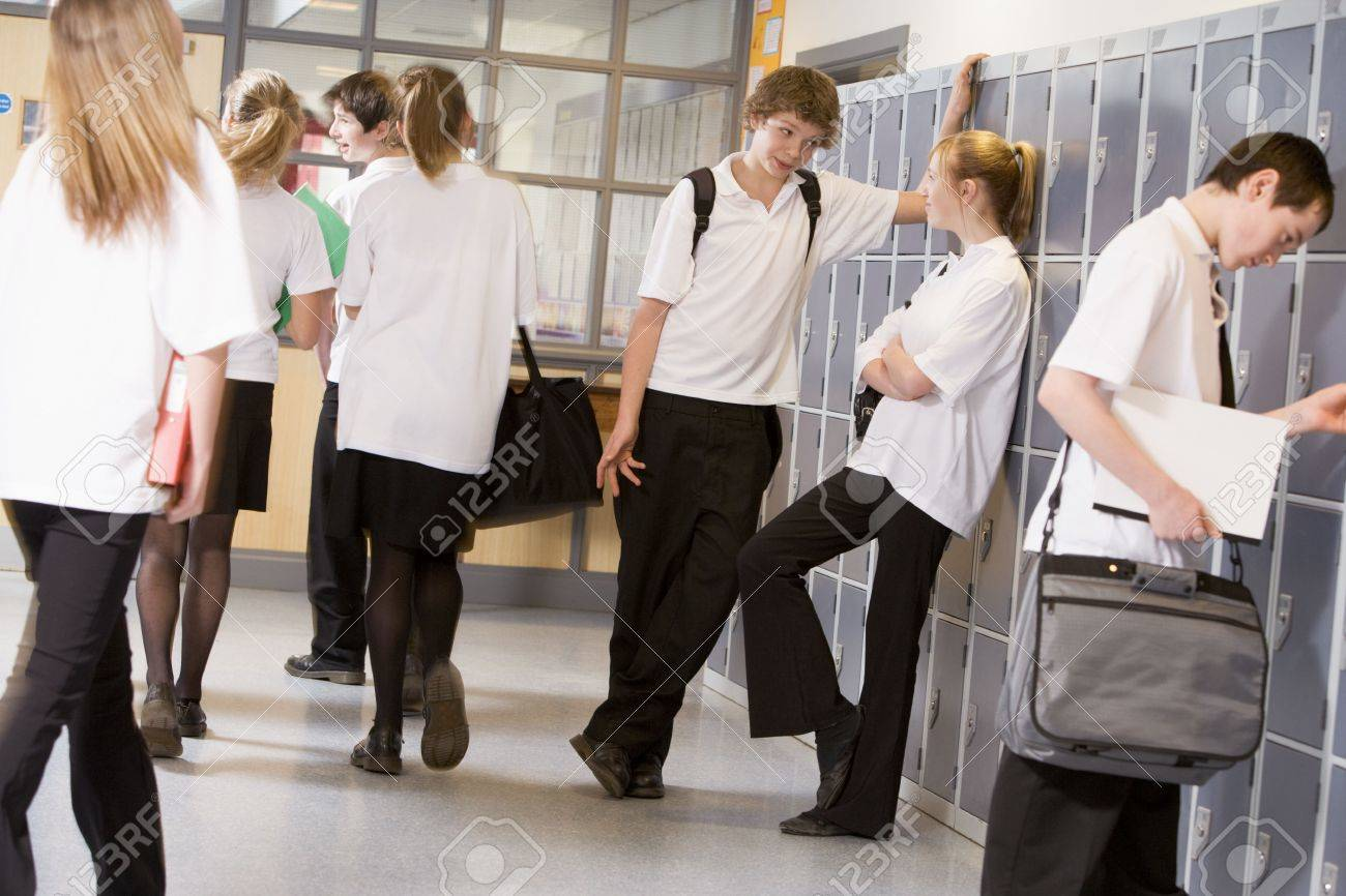 Secondary school students in a school hallway Stock Photo - 3204260