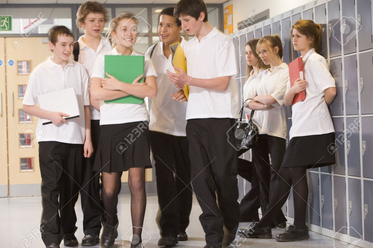 Secondary school students in a school hallway Stock Photo - 3204264