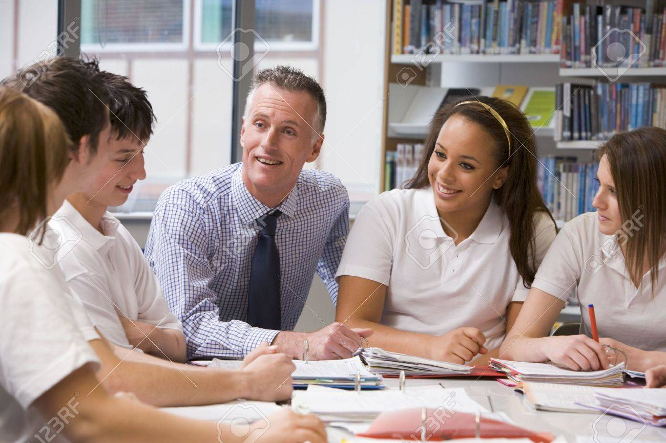 Students and teacher in a study group collaborating Stock Photo - 3204265
