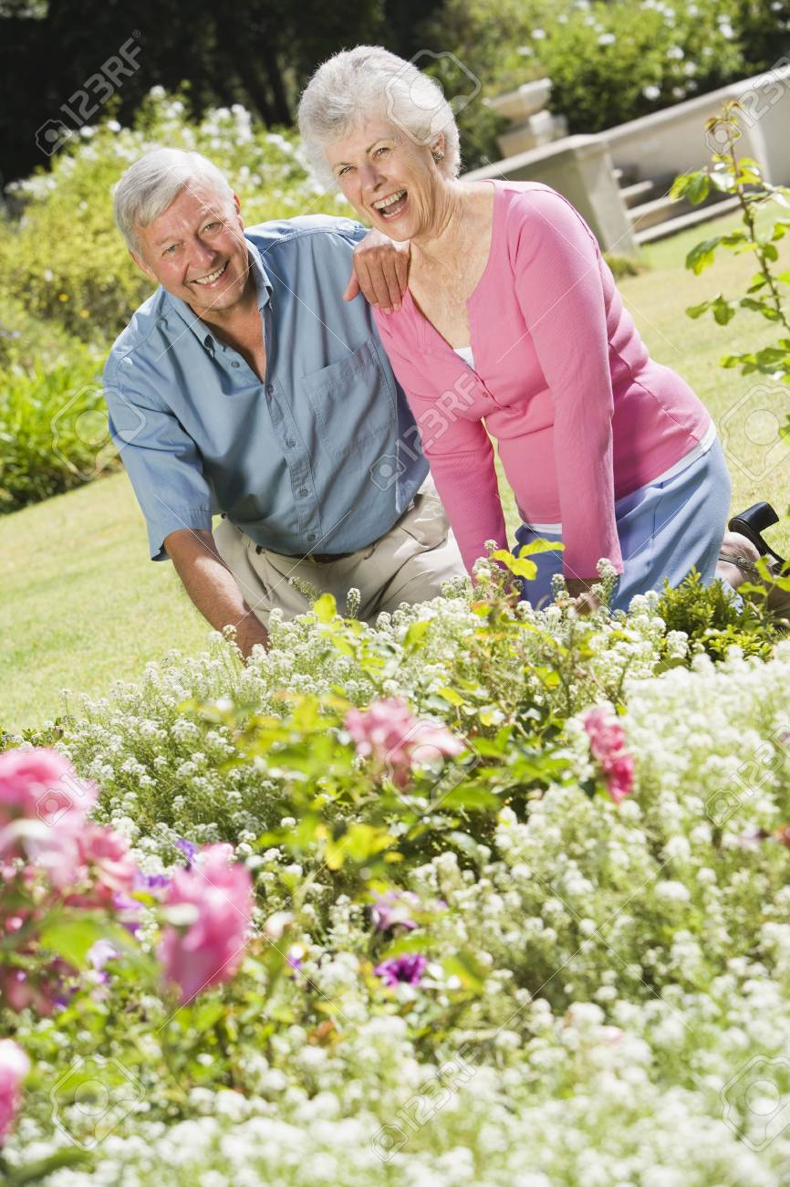 Senior couple in a flower garden Stock Photo - 3177570