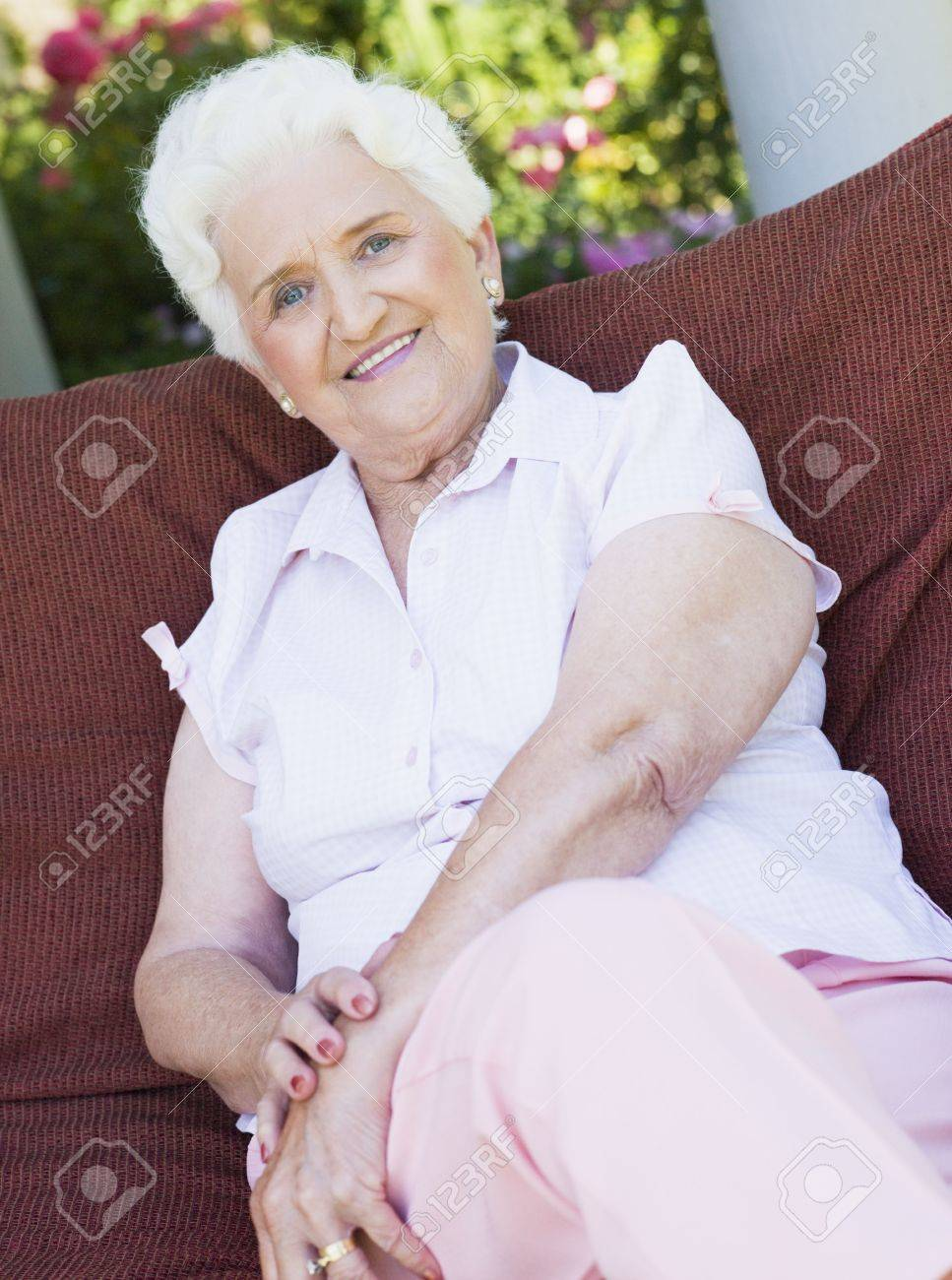 Senior woman sitting outdoors on a chair Stock Photo - 3177587
