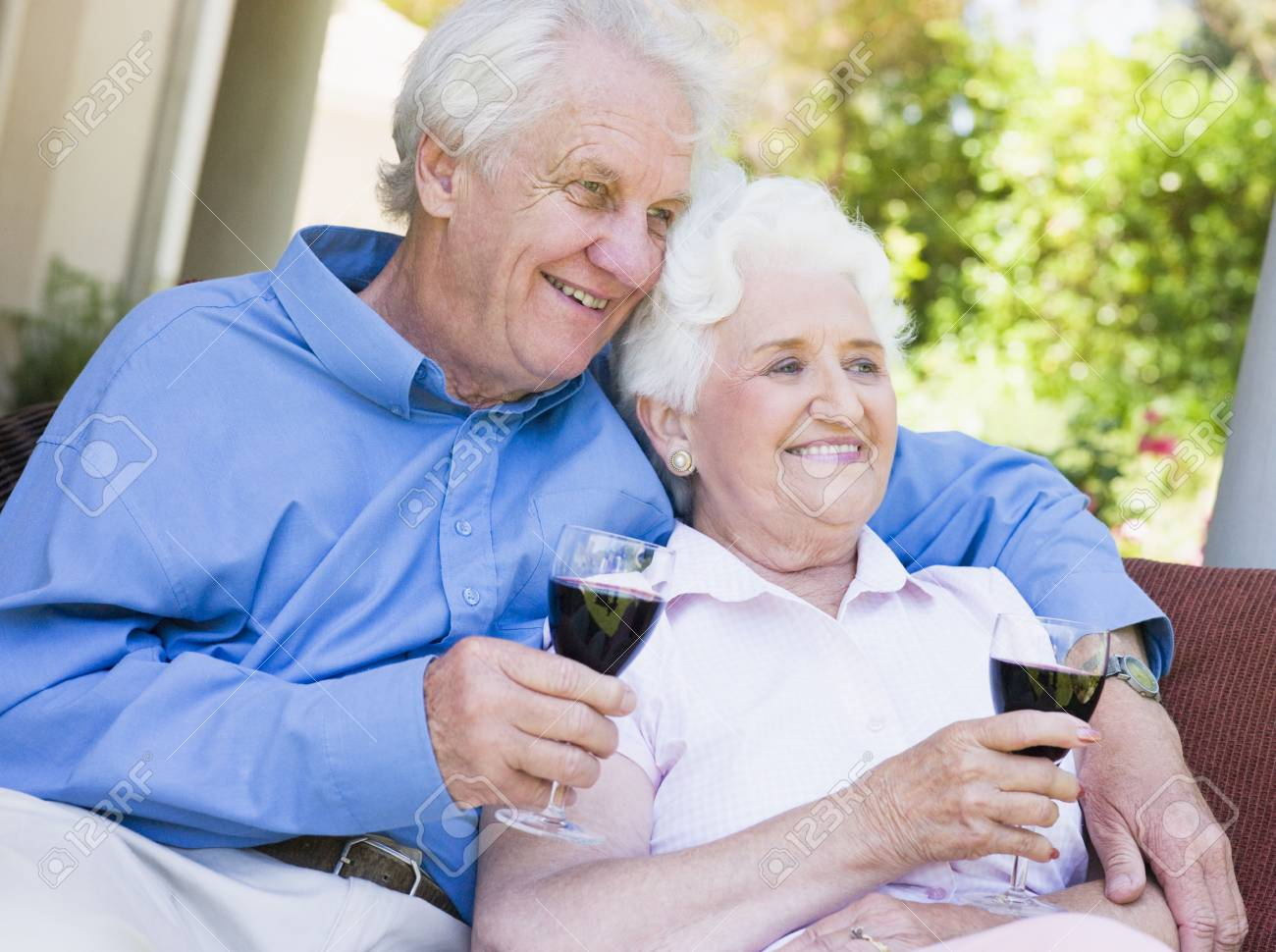 Senior couple sitting outdoors having a glass of red wine Stock Photo - 3177533