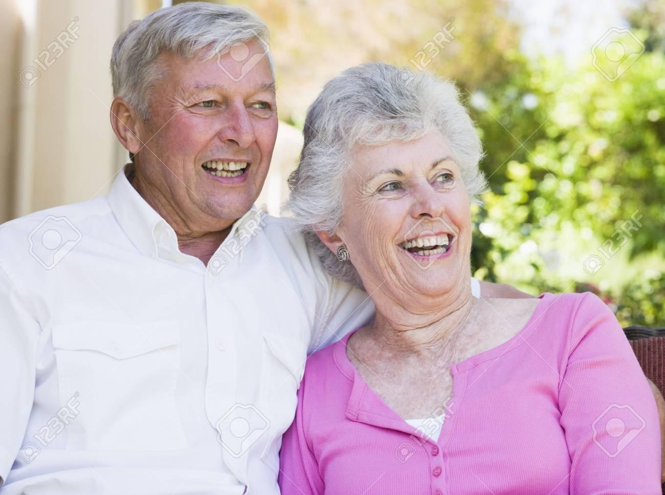 Senior couple sitting outdoors Stock Photo - 3177578