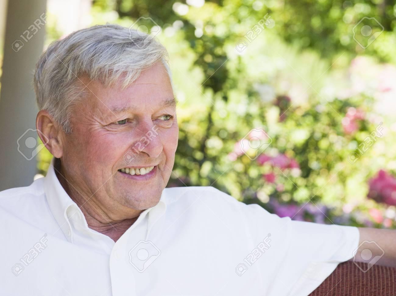Senior man sitting outdoors Stock Photo - 3177602