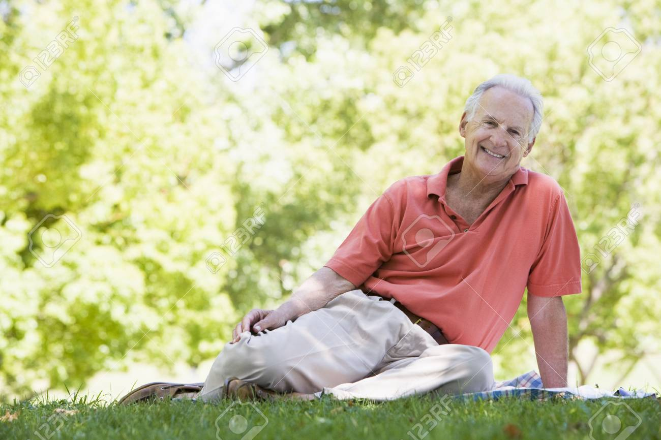 Senior man sitting outdoors Stock Photo - 3177129